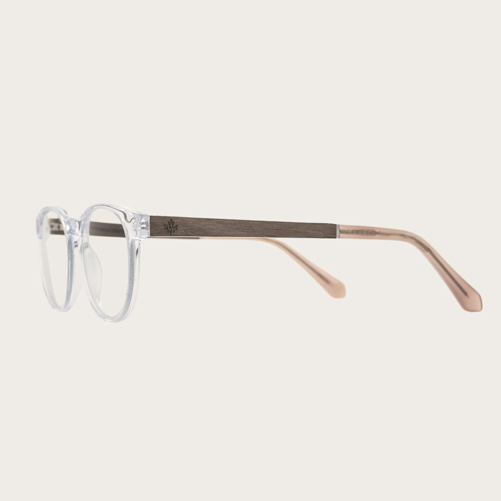 """Clear specs fitted with our BlueBlock lenses. Filter out harmful excess blue light which can cause eye strain, headaches and poor sleep. The Ellipse """"Clear"""" features a characteristic rounded clear frame and is composed of durable Italian Mazzucchelli bio-"""