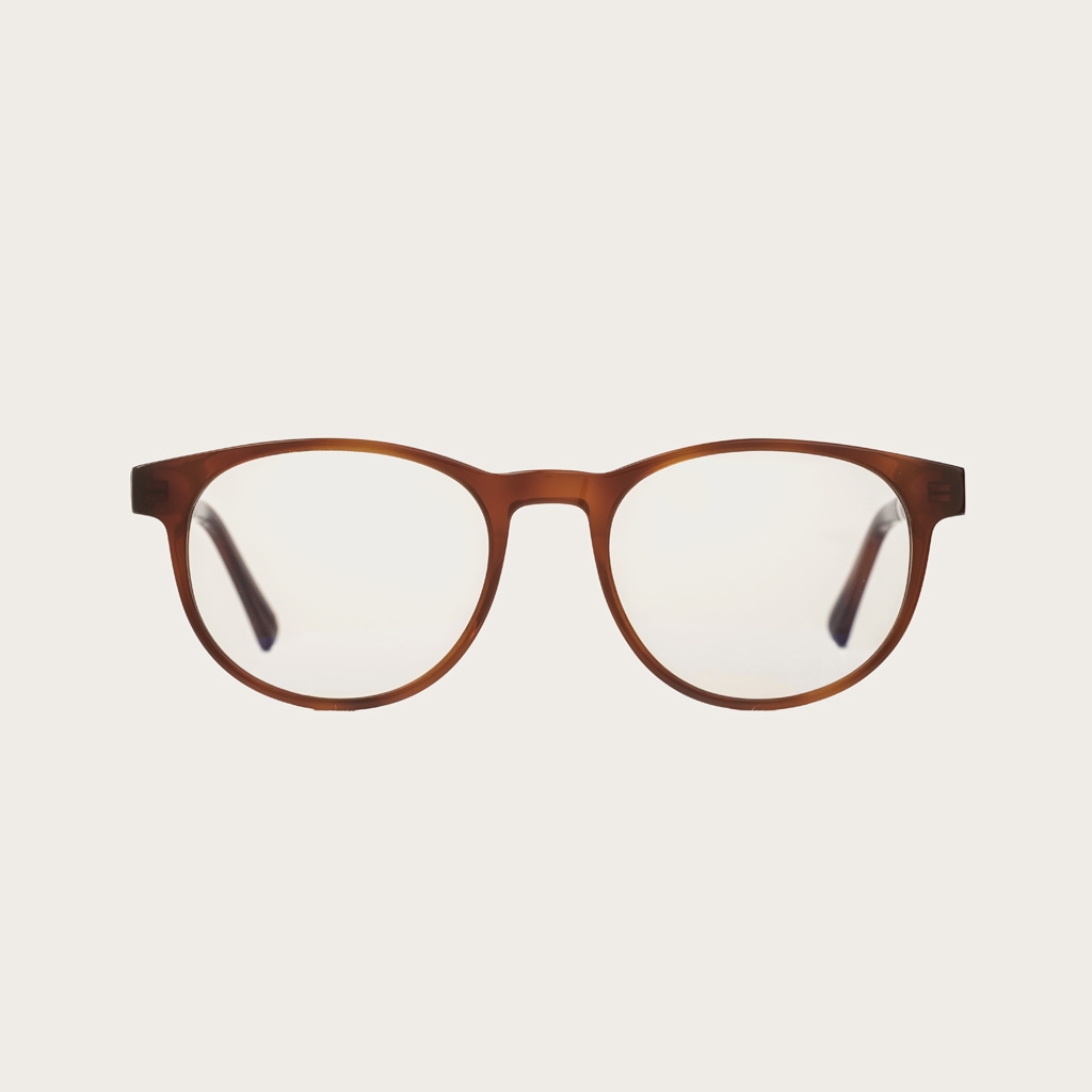 """Clear specs fitted with our BlueBlock lenses. Filter out harmful excess blue light which can cause eye strain, headaches and poor sleep. The Ellipse """"Classic Havanas"""" features a characteristic rounded dark yellow tortoise frame and is composed of durable"""