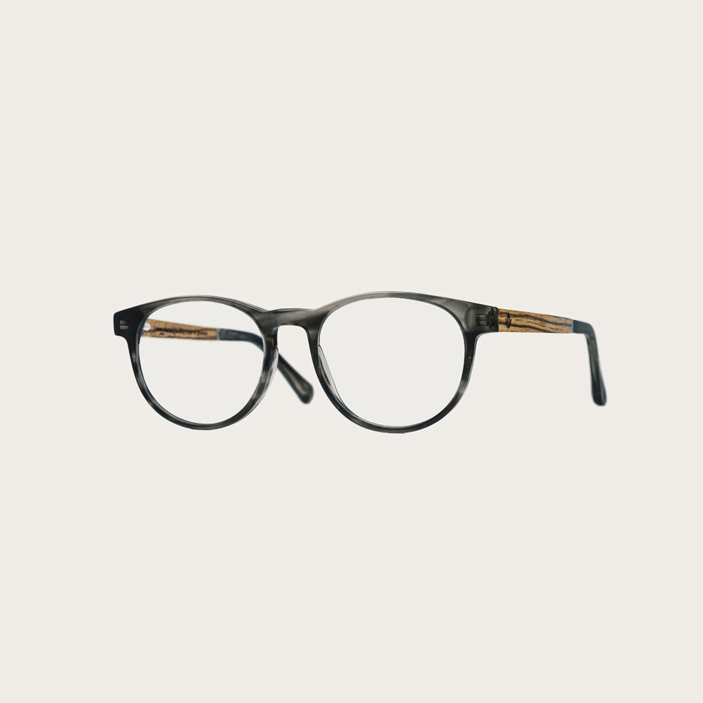 """Clear specs fitted with our BlueBlock lenses. Filter out harmful excess blue light which can cause eye strain, headaches and poor sleep. The Ellipse """"Heritage"""" features a characteristic rounded grey tortoise frame and is composed of durable Italian Mazzuc"""