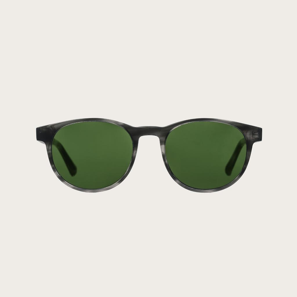 The ELLIPSE Heritage Camo features a characteristic rounded grey tortoise frame with green camo lenses. Composed of durable Italian Mazzucchelli bio-acetate with hand-finished natural zebrawood temples and tortoise acetate tips. Bio-acetate is made from c