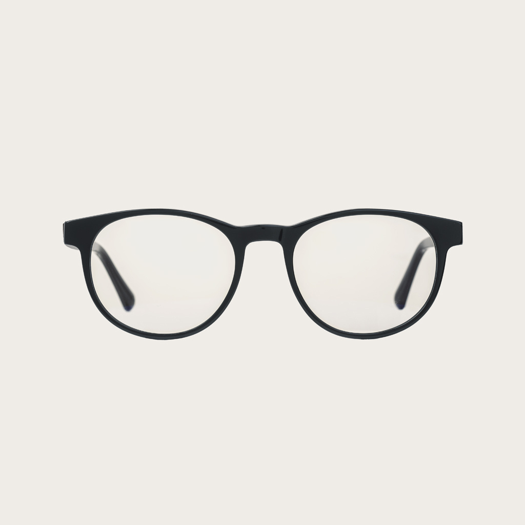 """Clear specs fitted with our BlueBlock lenses. Filter out harmful excess blue light which can cause eye strain, headaches and poor sleep. The Ellipse """"Black"""" features a characteristic rounded black frame and is composed of durable Italian Mazzucchelli bio-"""