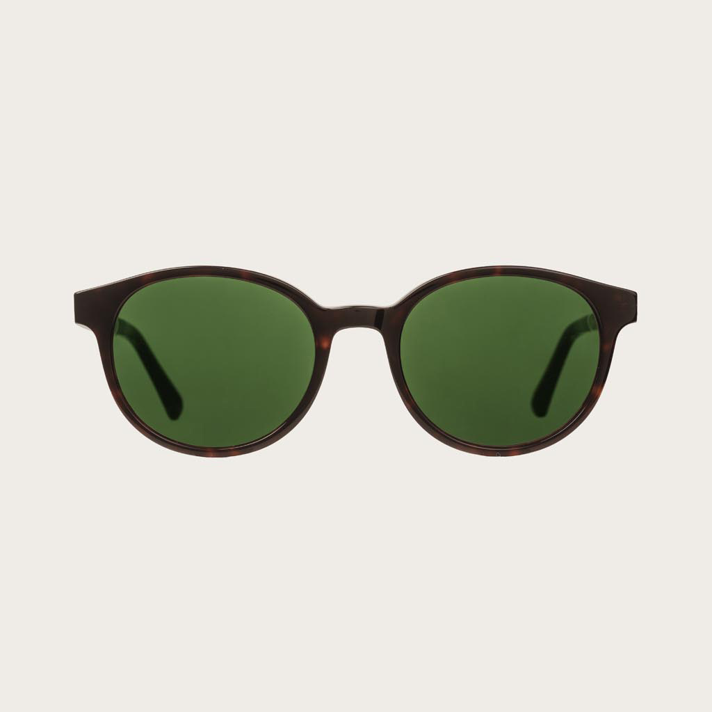 The SOHO Forever Havanas Camo features an oval dark brown tortoise frame with green camo lenses. Composed of durable Italian Mazzucchelli bio-acetate with hand-finished natural ebony temples and tortoise acetate tips. Bio-acetate is made from cotton and o