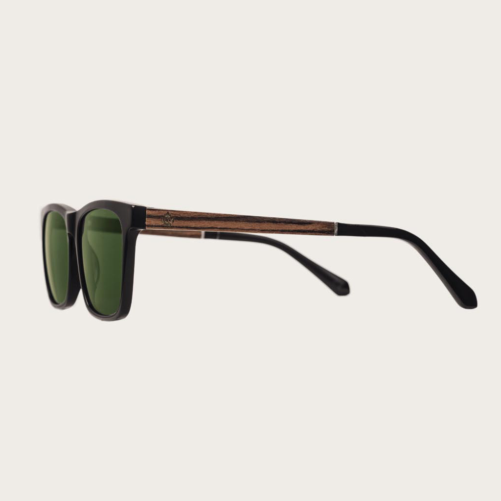 The BROOKLYN Black Camo features a squared black frame with green camo lenses. Composed of durable Italian Mazzucchelli bio-acetate with hand-finished natural rosewood temples and black acetate tips. Bio-acetate is made from cotton and organic resins maki
