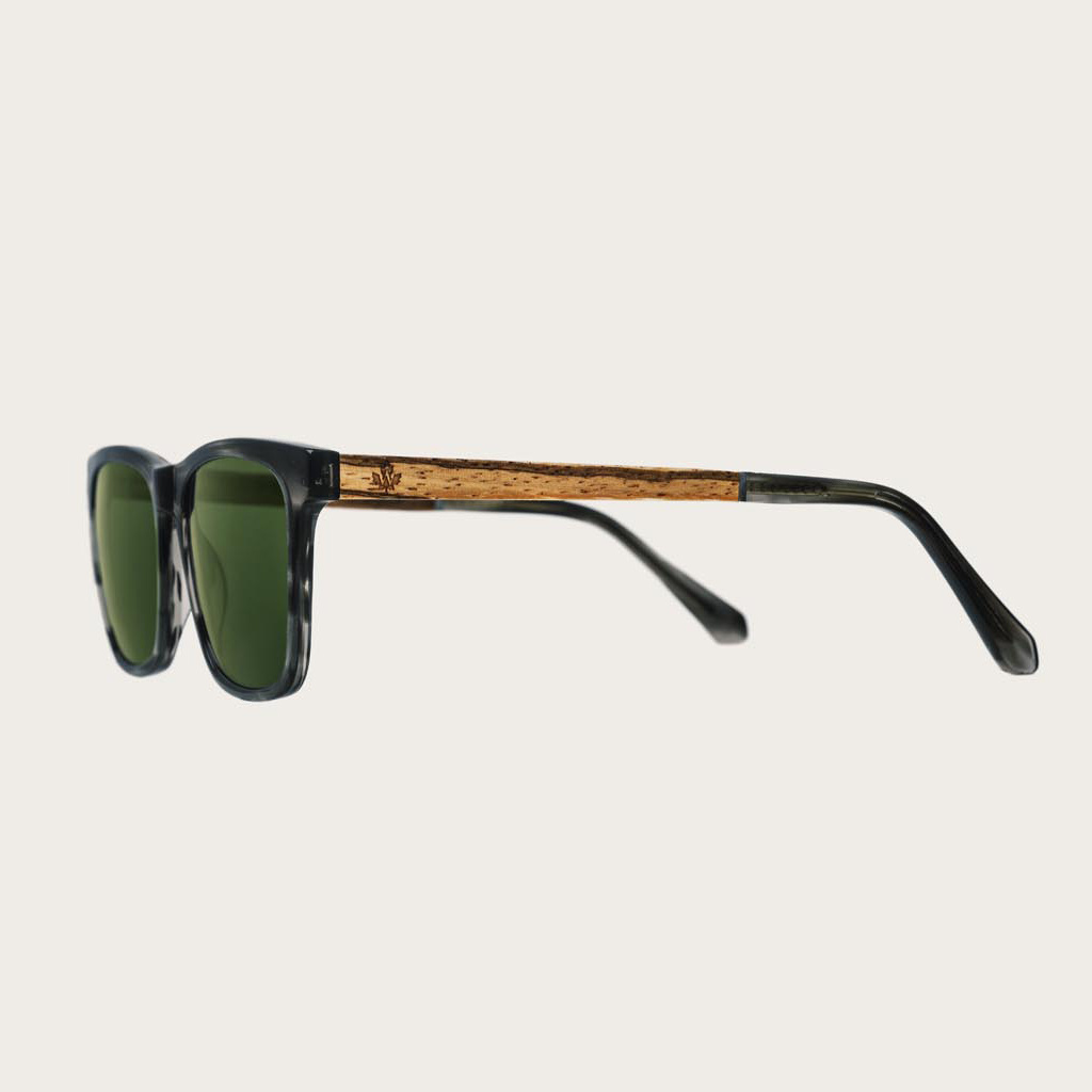 The BROOKLYN Heritage Camo features a squared grey tortoise frame with green camo lenses. Composed of durable Italian Mazzucchelli bio-acetate with hand-finished natural zebrawood temples and tortoise acetate tips. Bio-acetate is made from cotton and orga