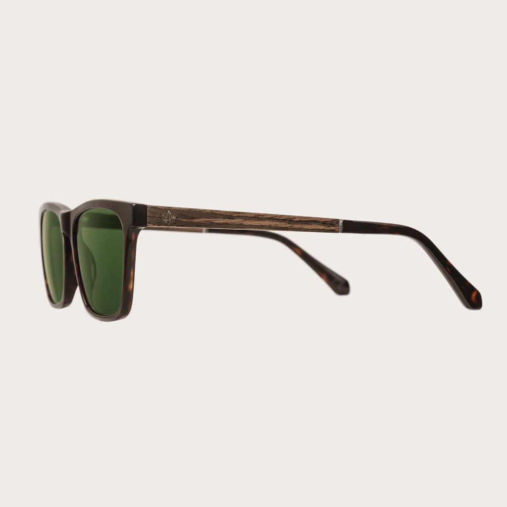 The BROOKLYN Forever Havanas Camo features a squared dark brown tortoise frame with green camo lenses. Composed of durable Italian Mazzucchelli bio-acetate with hand-finished natural ebony temples and tortoise acetate tips. Bio-acetate is made from cotton