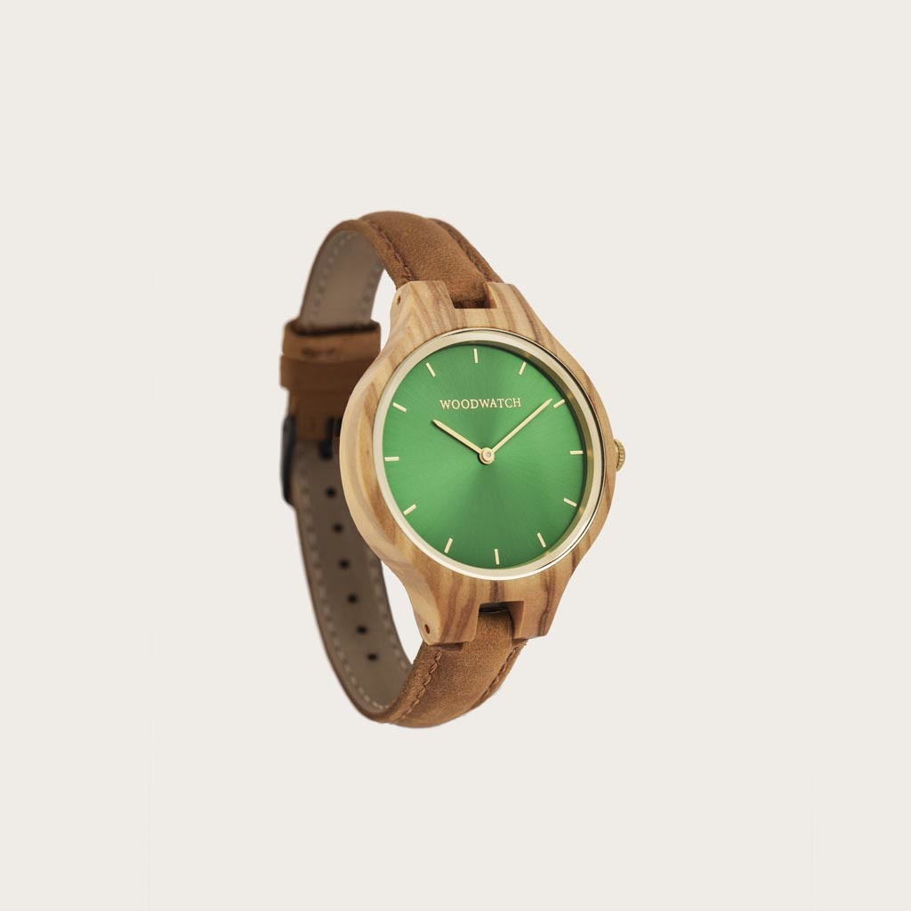 The AURORA Collection breaths the fresh air of Scandinavian nature and the astonishing views of the sky. This light weighing watch is made of olive wood, accompanied by a green stainless-steel dial with golden details.<br /> The watch is available with a woode
