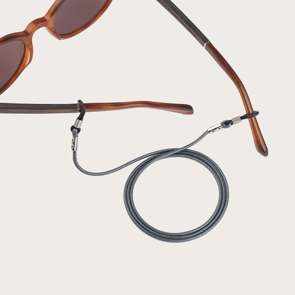 Tired of losing or breaking your glasses or sunglasses? We are dedicated to protecting your eyewear, fashionably. Oozing with style, this subtle, grey leather-look cord can be perfectly matched with your WoodWatch Eyewear, or simply attach it to your own