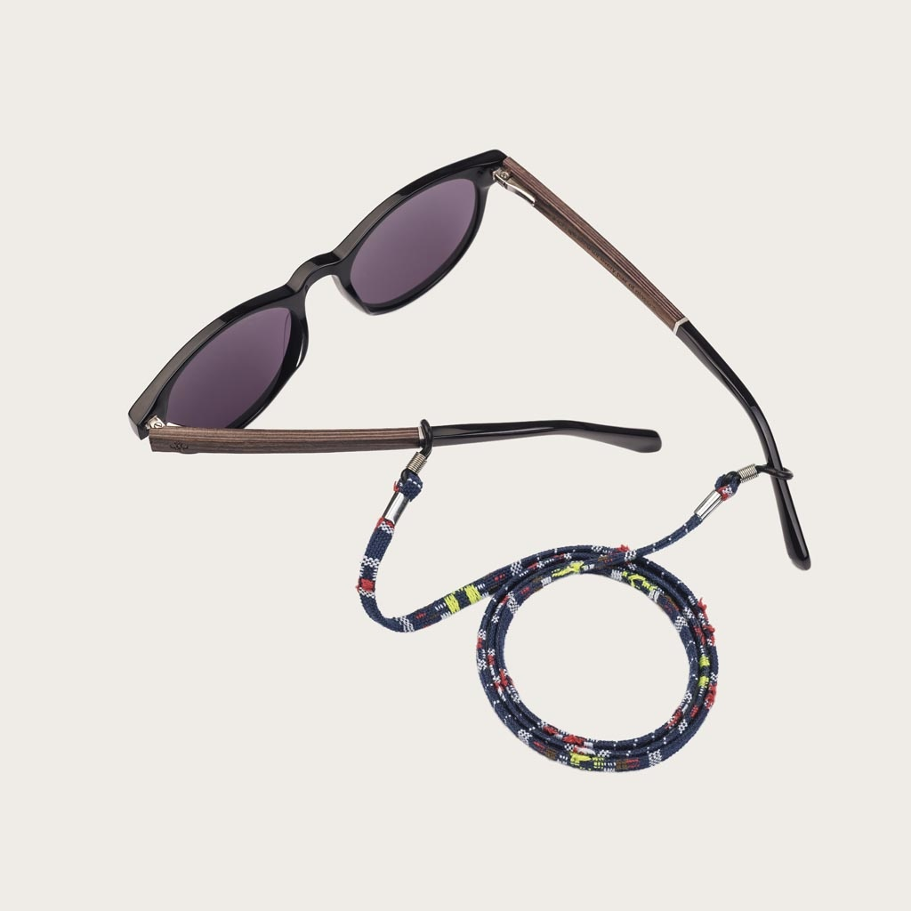 Tired of losing or breaking your glasses or sunglasses? We are dedicated to protecting your eyewear, fashionably. Oozing with style, this contemporary, navy cord with colourful details can be perfectly matched with your WoodWatch Eyewear, or simply attach