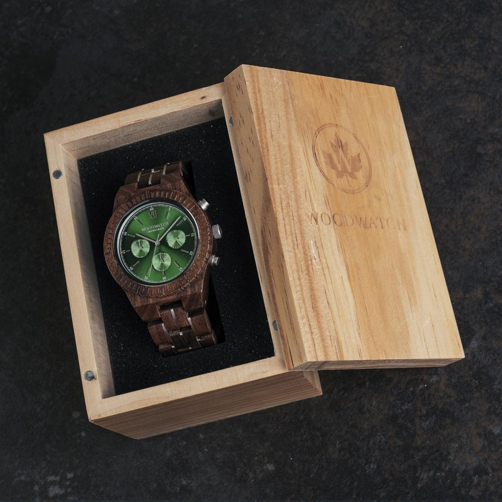 Prepare for adventure with our fully featured, hand-crafted Chronograph wrist watch. This premium design watch features a 45mm walnut wood case, green stainless steel dial and a SEIKO VD54 movement. The unique new strap combines sustainable walnut wood wi
