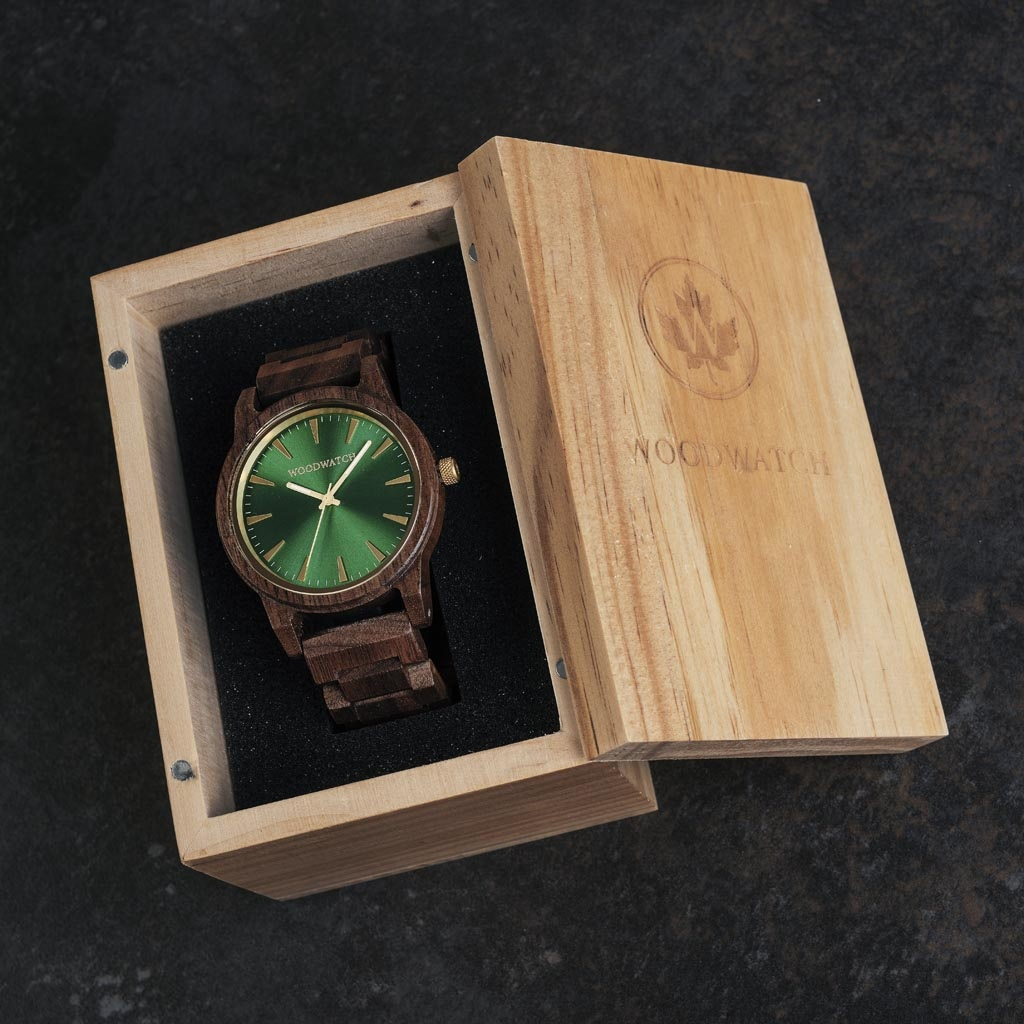 The Camo Walnut features a modernized minimal green dial with bold details in a 45mm case. A wrist essential combining natural wood with stainless steel and sapphire coated glass. The Camo Walnut is handmade from American Walnut Wood.