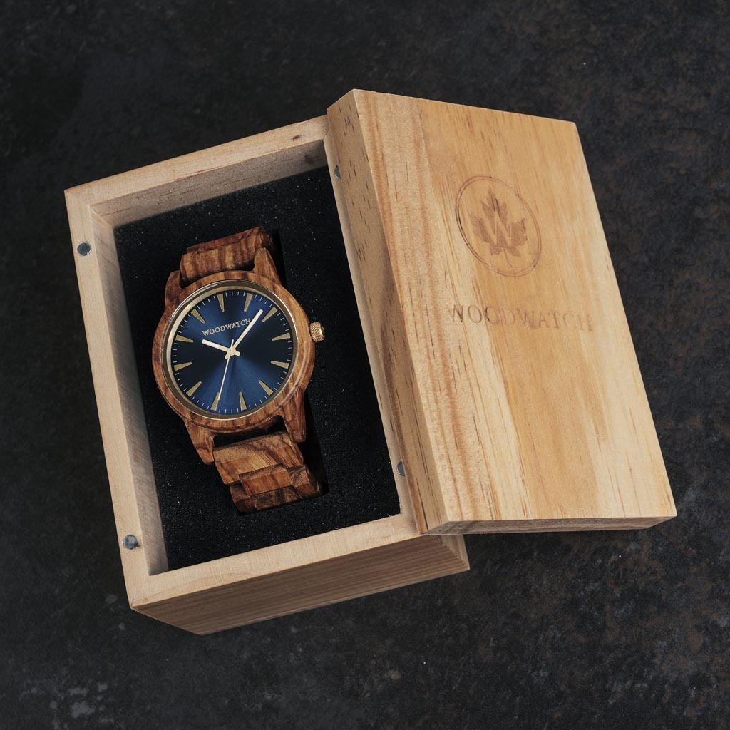 The Astro Kosso features a modernized minimal blue dial with bold details in a 45mm case. A wrist essential combining natural wood with stainless steel and sapphire coated glass. The Astro Kosso is handmade from natural Kosso wood from East Africa.