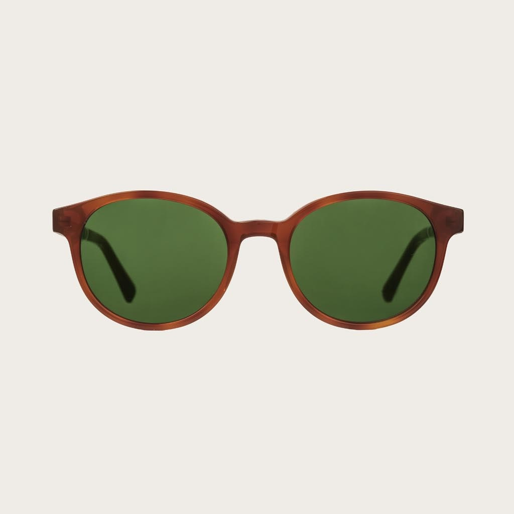 The SOHO Classic Havanas Camo features an oval dark yellow tortoise frame with green camo lenses. Composed of durable Italian Mazzucchelli bio-acetate with hand-finished natural ebony temples and tortoise acetate tips. Bio-acetate is made from cotton and