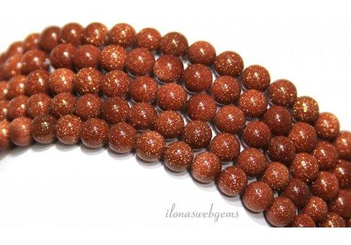 Goldstone beads around gold around 6mm