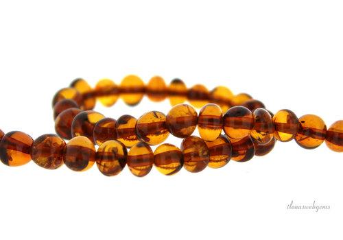 Amber beads around 7x5mm