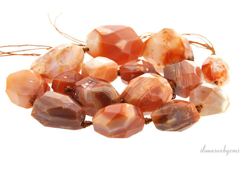 Striped agate beads red free shape ascending and descending from approximately 21x19 to 38x23mm
