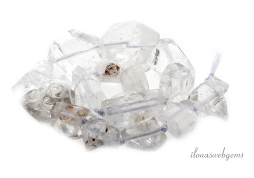 Rock crystal beads ascending and descending from around 15x12 to 30x24mm