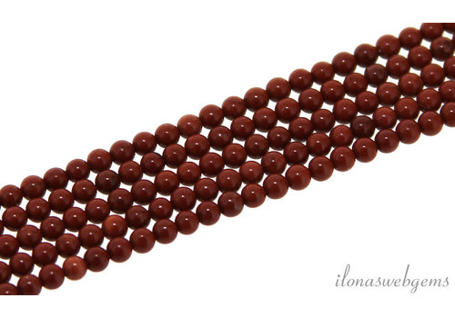 Red Jasper beads around mini about 2mm