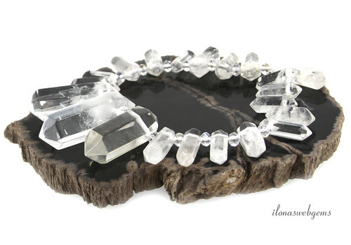 Rock crystal points ascending and descending from approx. 20x8 to 35x20mm