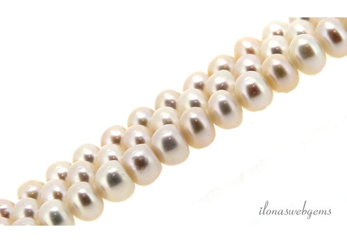 Freshwater pearls white roundel about 6x5mm