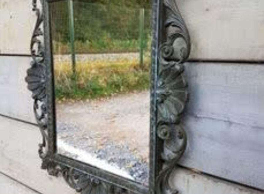 Mirror in patinated bronze
