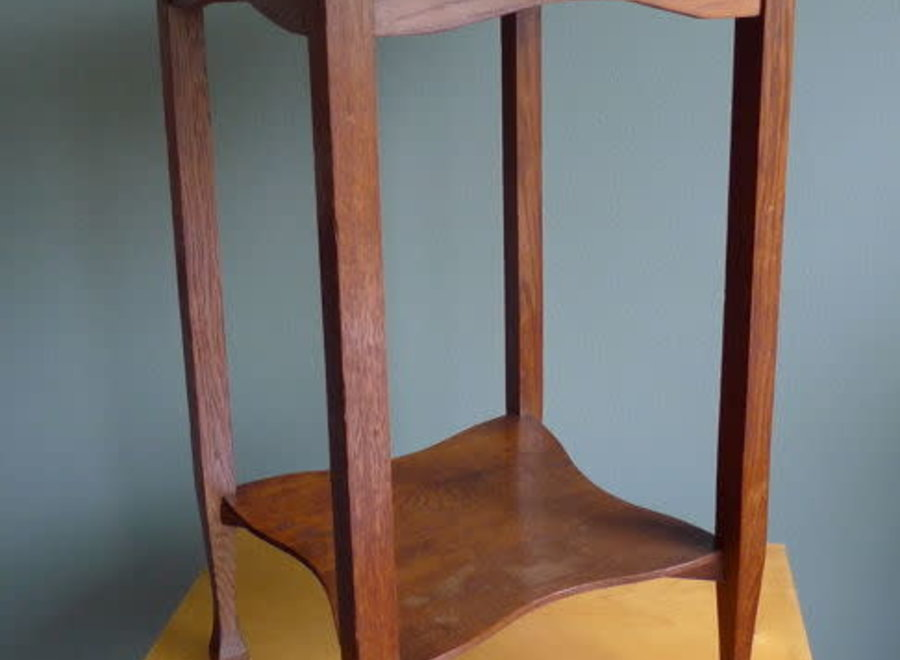 Round, oak smoking table with copper top from the thirties.