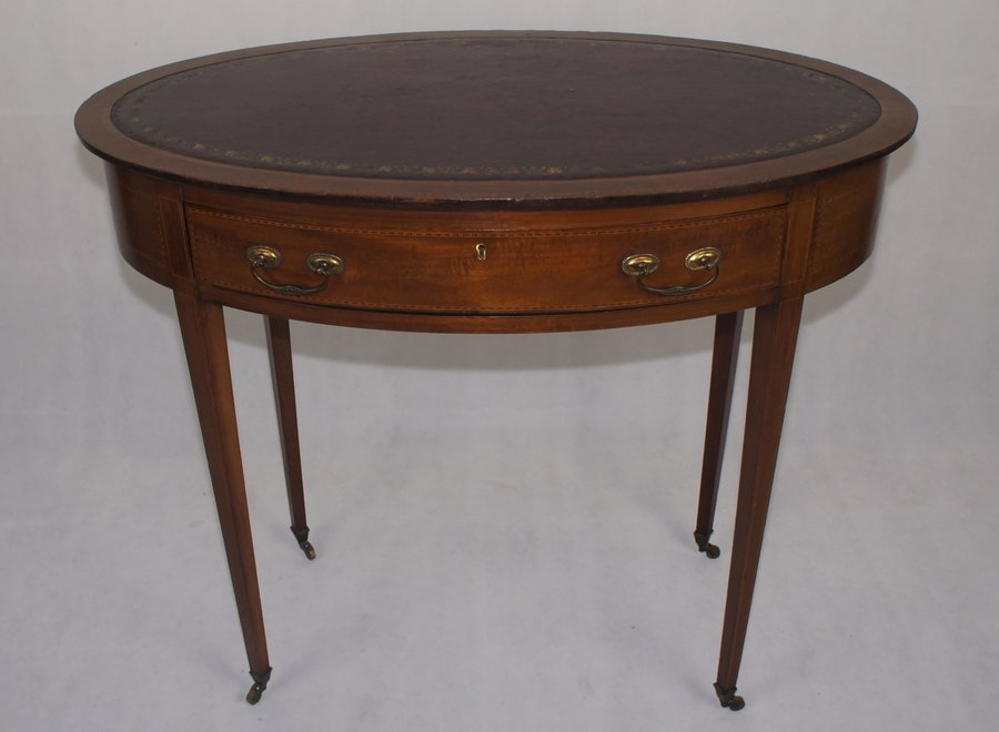 Oval writing table with drawer and leather - on wheels - UK - Ca 1910