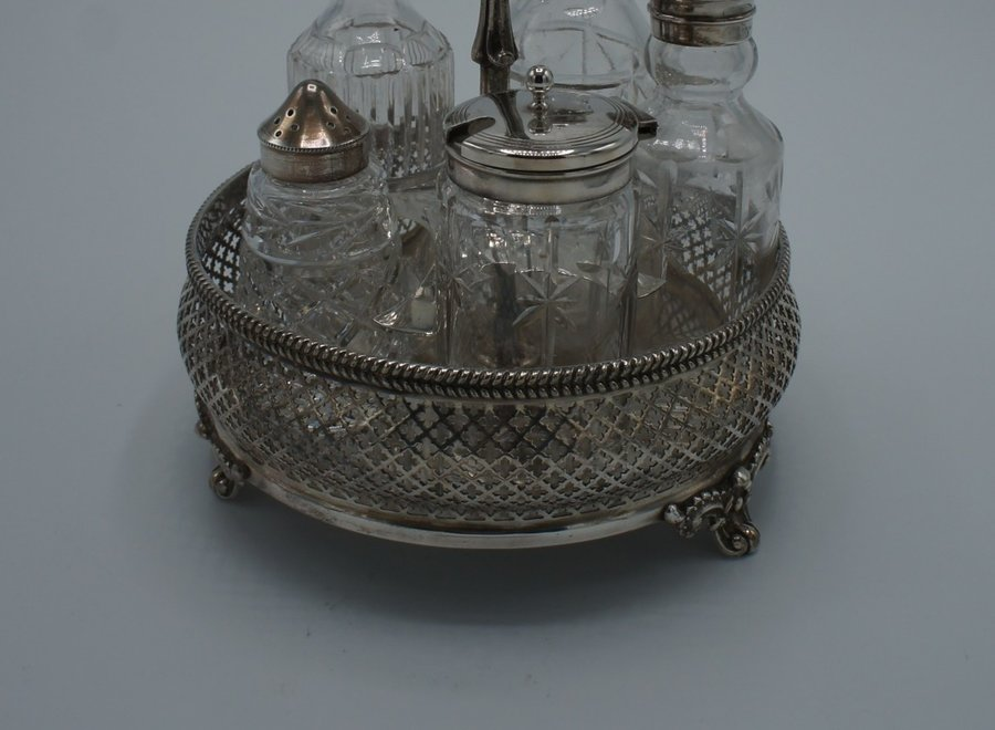 Antique silver plated holder with 5 bottles for spices and oil.