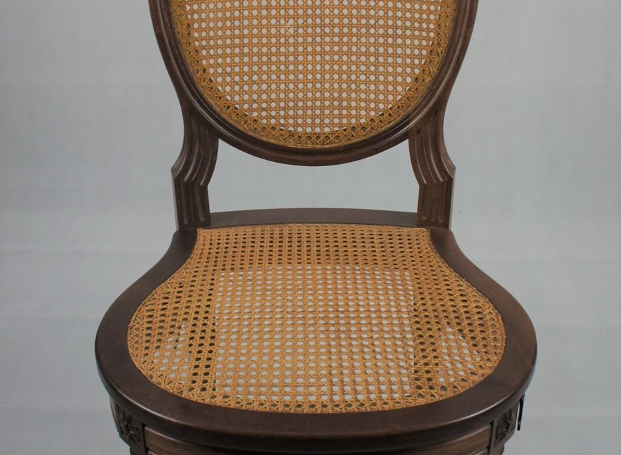 Antique chair with webbing
