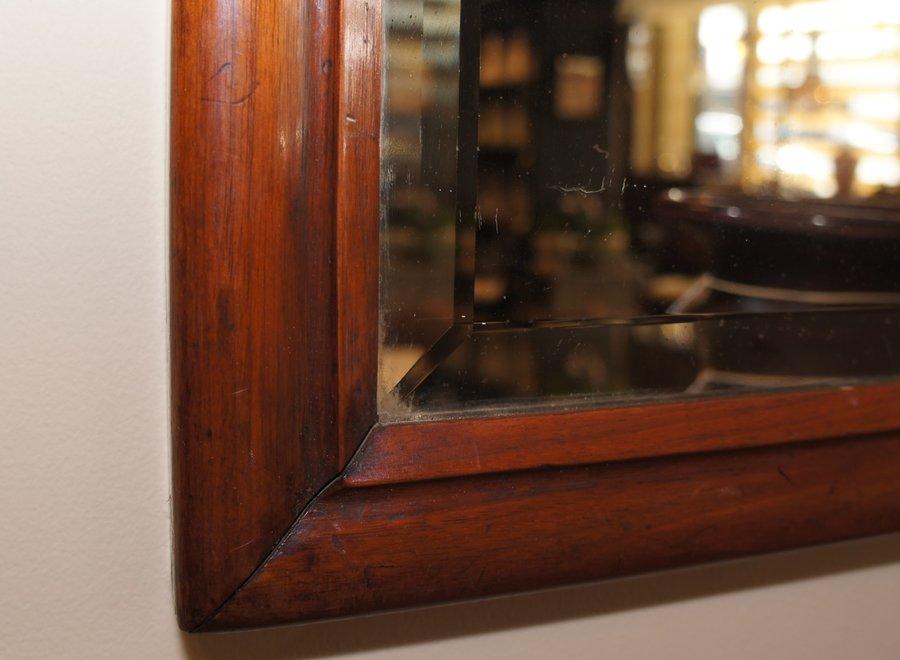 Elegant antique  mahogany frame with cut mirror