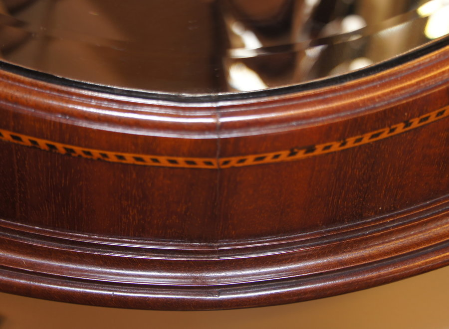 Beautiful oval Edwardian mahogany frame with cut mirror
