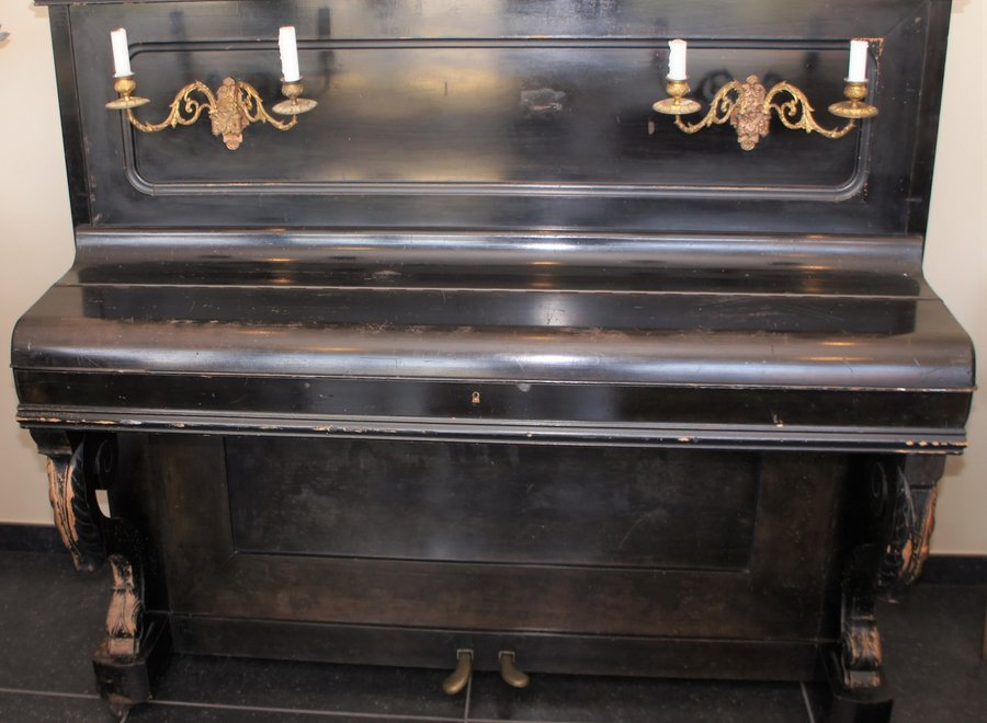 Buffet piano with candlesticks