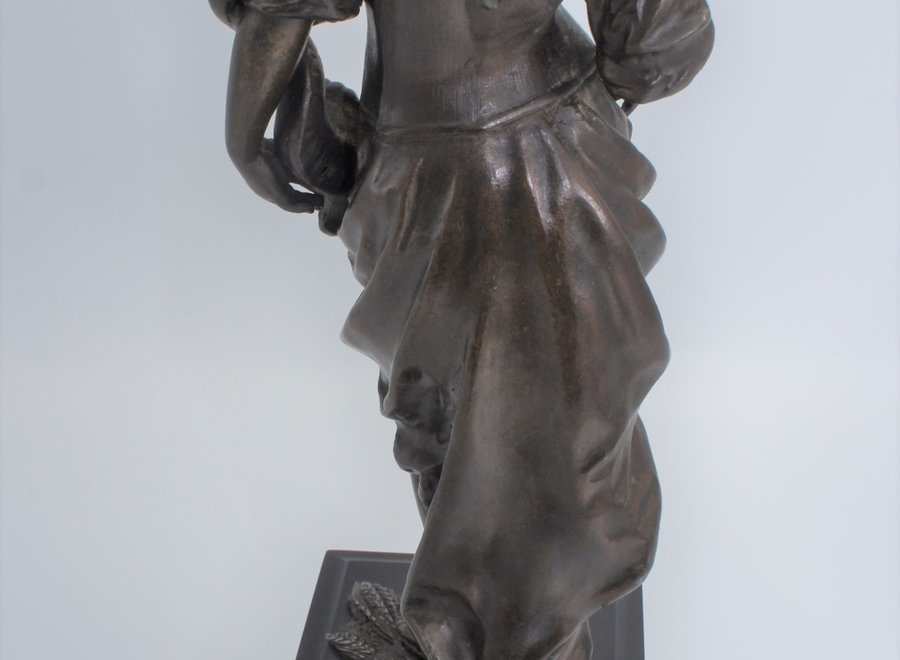 Romantic statue of a woman with sickle