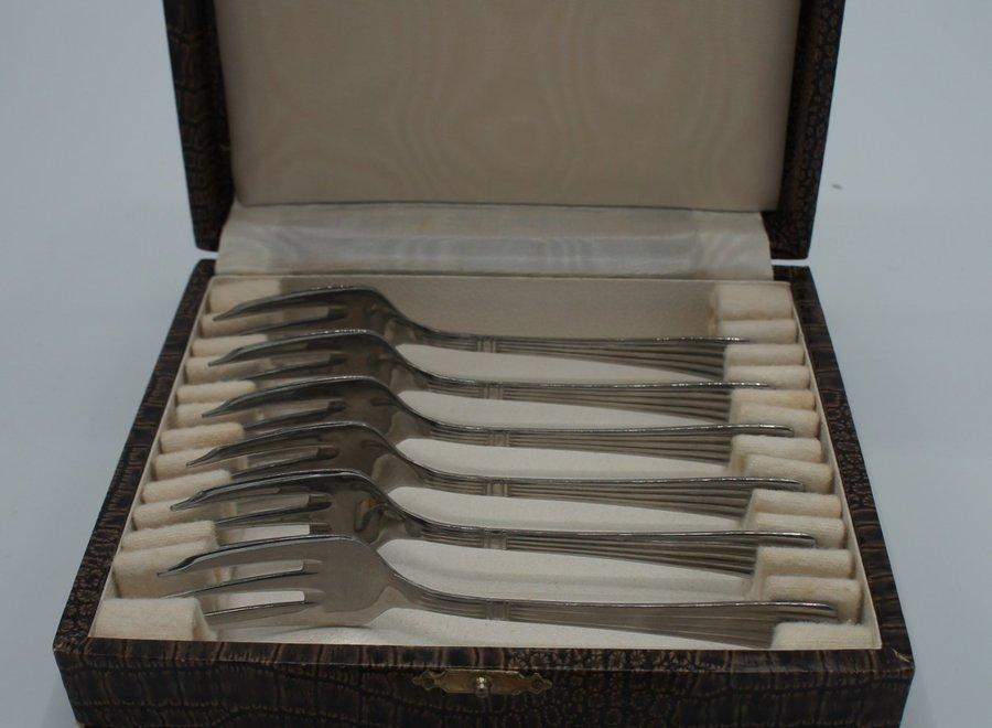 Set van 6 oude dessertvorken in Inox in koffer