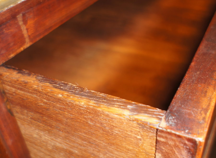 Antique chest of drawers in various types of wood