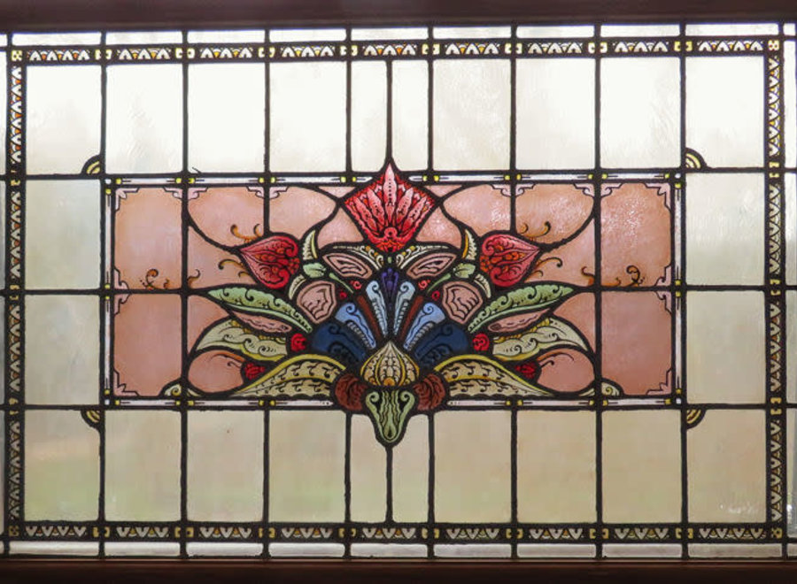 Stained glass window with floral motifs