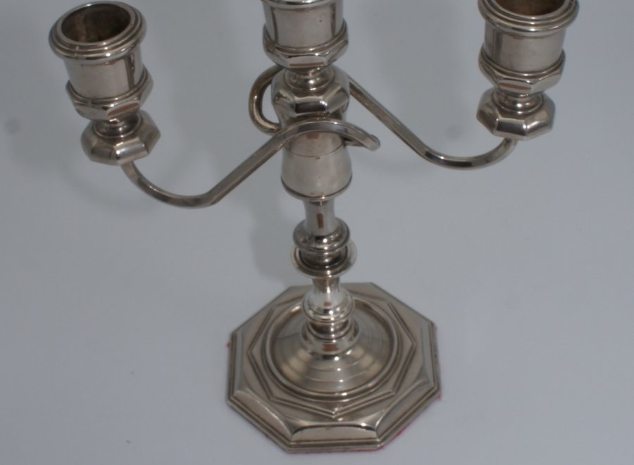 Elegant three-armed candlestick