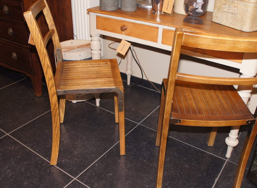 Oak chair with metal reinforcement on the side