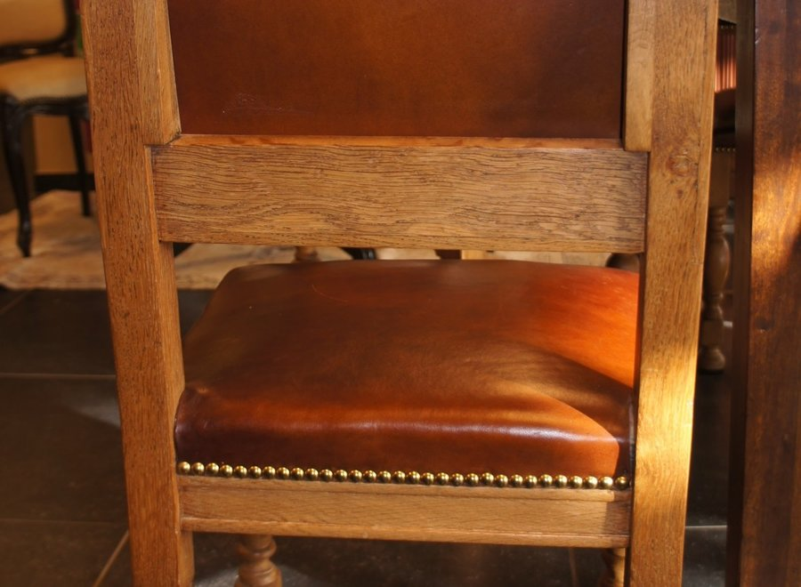 Light oak chair with leather seat and back