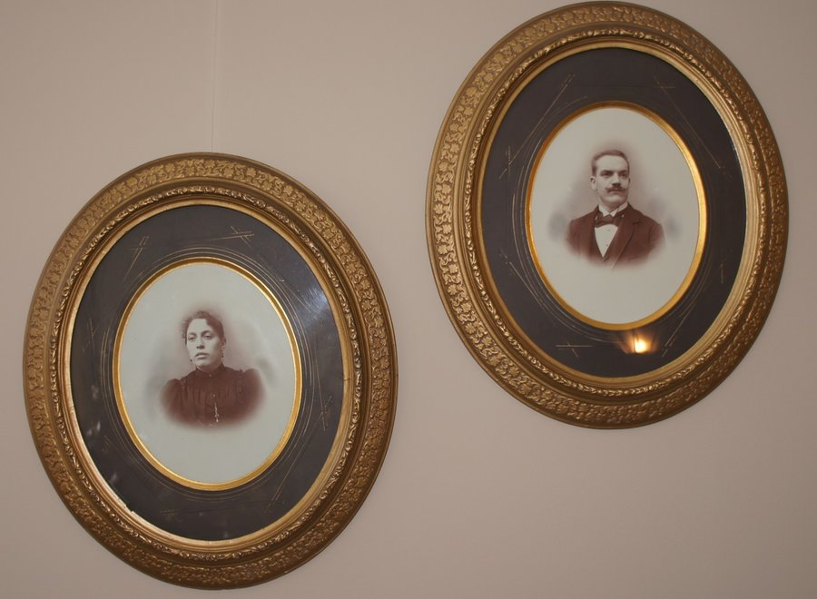 Couple family portraits in an authentic oval frame