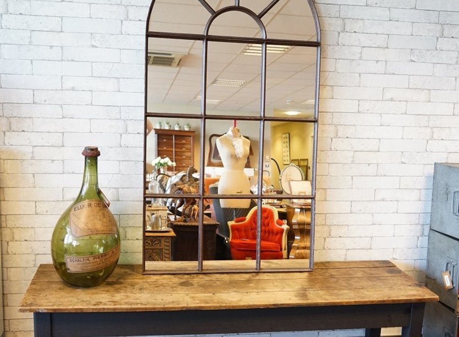 Old industrial mirror in varnished rust patina metal
