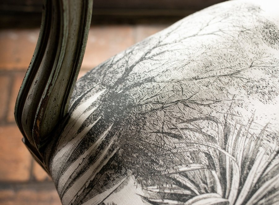 Patinated armchair Louis XVI