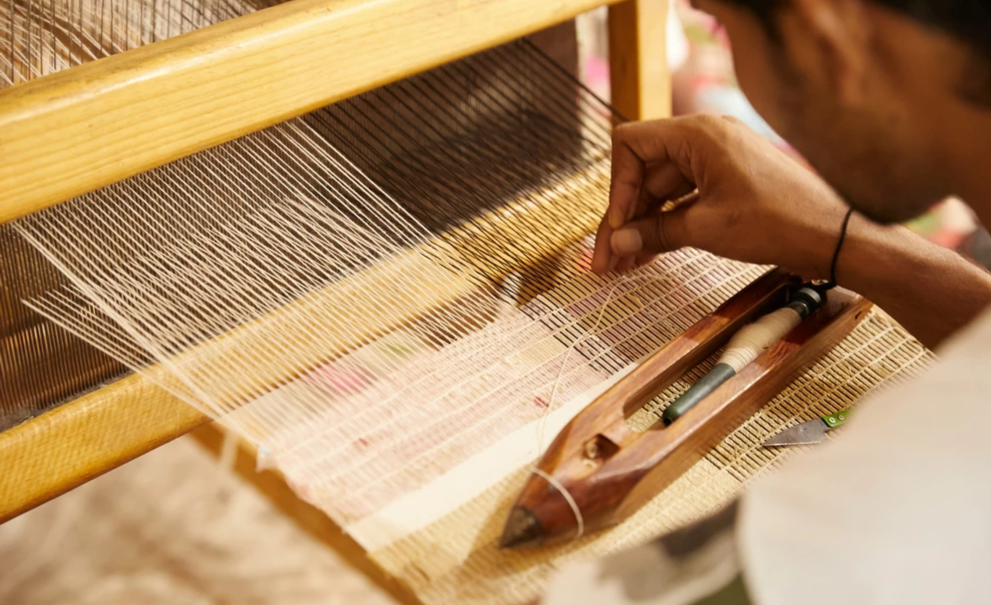 Weaving recycled silk strips
