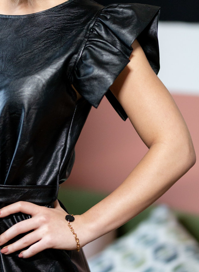 Planning your next night out with your Girl's? Update your wardrobe with this  black faux leather dress.