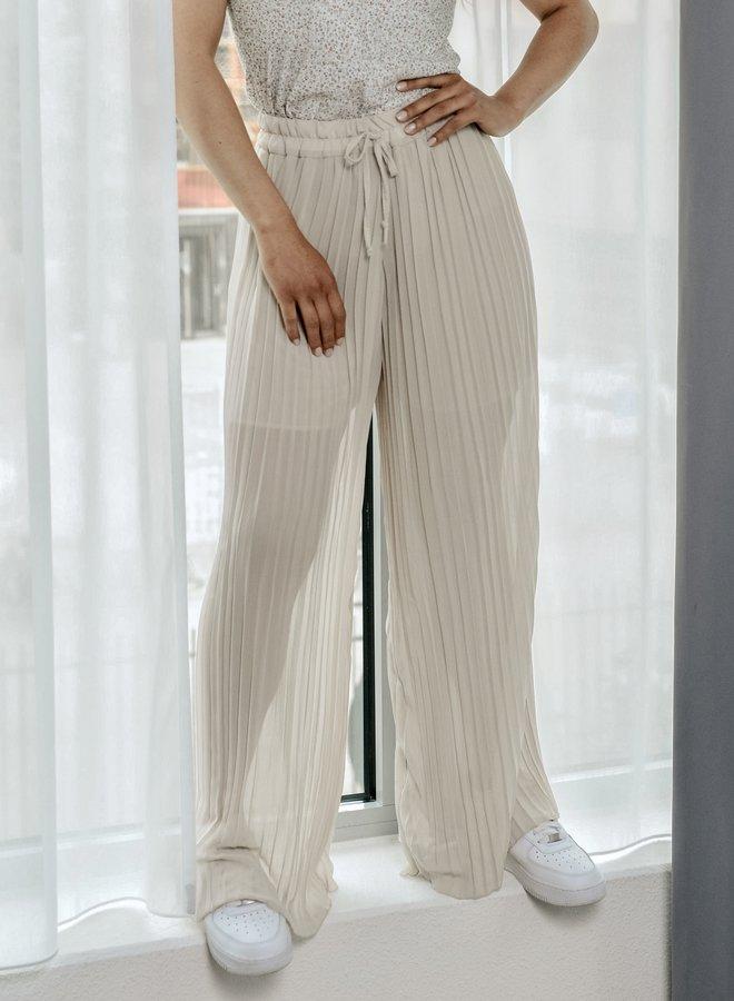 Pantalon transparant nude met plissé wijde pijpen