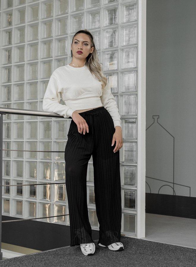 Zwart transparant pantalon met plissé wijde pijpen