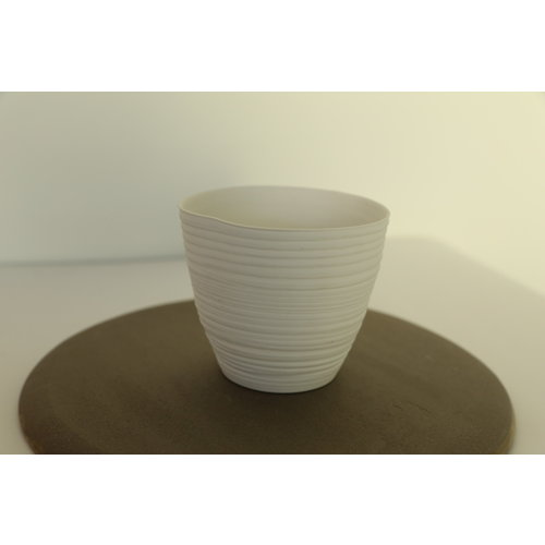 K!-design Koon is a white porcelain tealight with a beautiful playful light