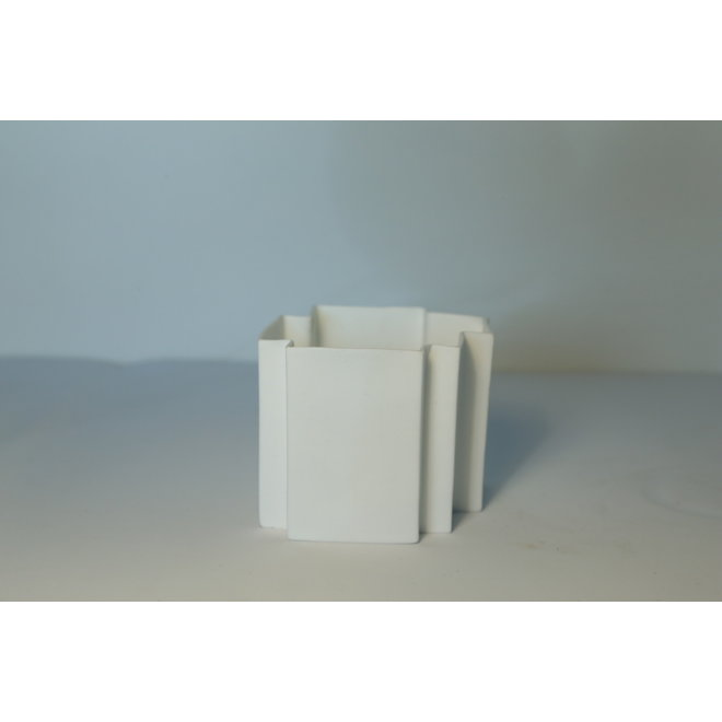 White porcelain thealight made in puzzle form that can be combined beautifully