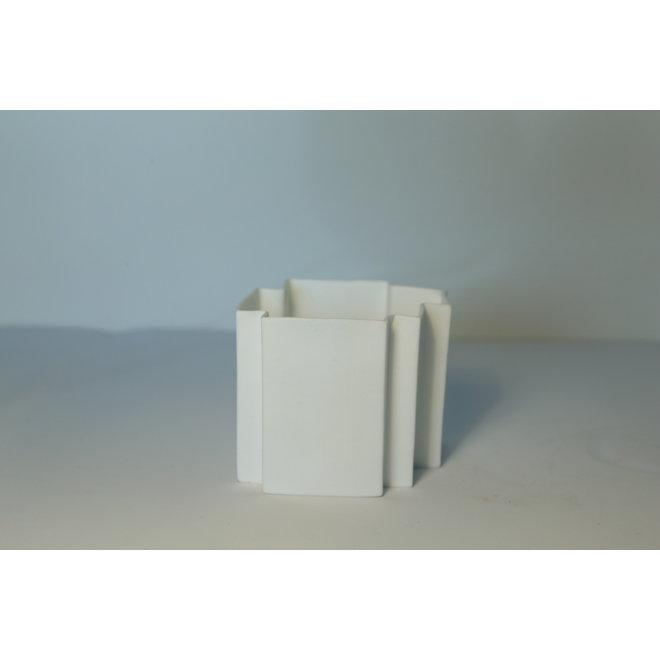 Wit porselein theelichtje gemaakt in puzzelvorm die samen mooi en uniek te combineren zijn