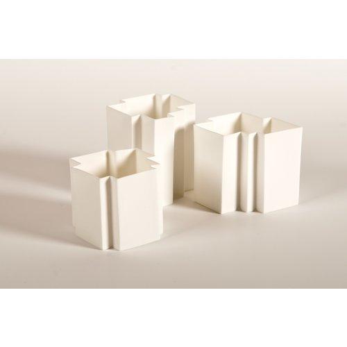 K!-design Une bougie chauffe-plat en porcelaine blanche conçue sous forme de casse-tête qui peut être combinée à la perfection et de façon unique