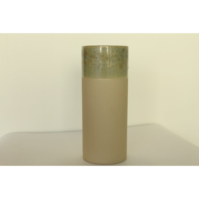 Handmade beige ceramic vase made in cast clay with a beautiful green border and adorns its age